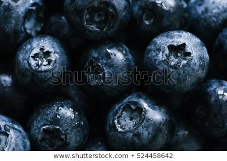 Fresh raw organic blueberries in pile. Macro close up Stock photo © DenisMArt