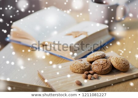 oat cookies almonds and book on table at home stock photo © dolgachov