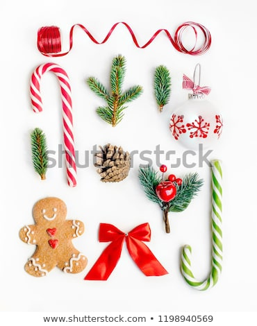 Winter stripe or fir branch with bow, ribbon and Christmas balls isolated on white background stock photo © heliburcka