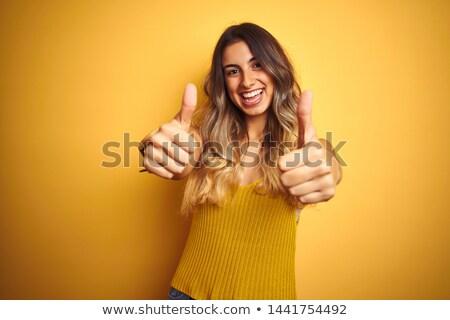 Stock fotó: Fiatal · nő · izolált · citromsárga · mutat · remek · kézmozdulat