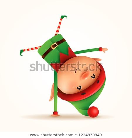 Pequeno elfo em pé braço de cabeça para baixo isolado Foto stock © ori-artiste