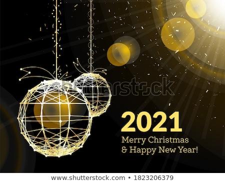 New Year's Christmas balls, on luminous golden ribbons, in the s Stock photo © m_pavlov