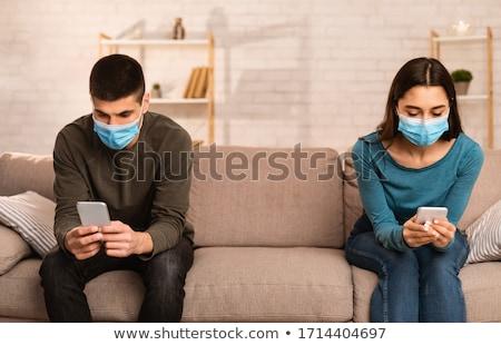 男 · 女性 · ホーム · 座って - ストックフォト © andreypopov