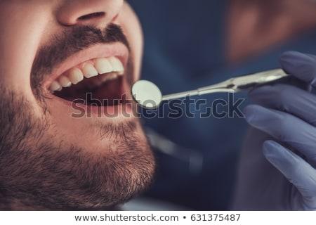 női · fogorvos · felfelé · férfi · beteg · fogak - stock fotó © dolgachov
