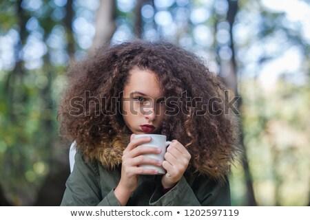 вьющиеся волосы подростка девушка кружка парка портрет Сток-фото © boggy