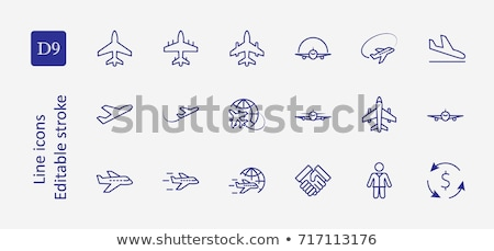 Travel Icon. Globe with plane icon. Vector illustration isolated on white background stock photo © kyryloff