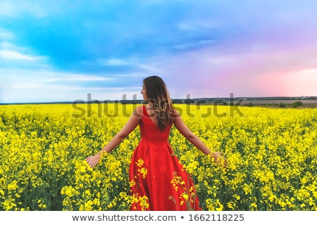 beautiful girl in blue dress with yellow flowers stock photo © svetography