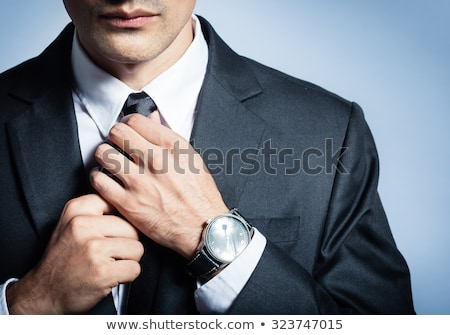 man in suit adjusting his buttons on his shirt Stock photo © feedough