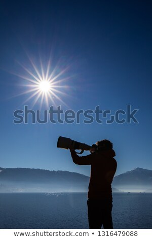 Young man devoting time to his favorite hobby - photography Stock photo © lightpoet