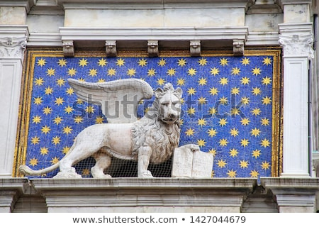Statue of winged lion on the Clock Tower at Piazza di San Marco  Stock photo © boggy