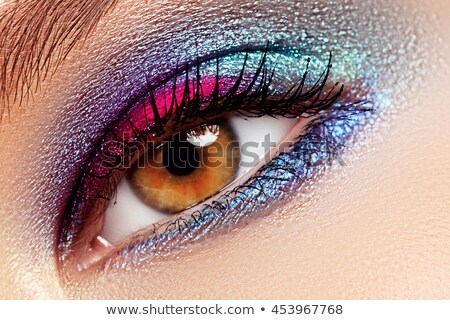Beauty, cosmetics and makeup. Magic eyes look with bright creative make-up. Macro shot of beautiful  Stock photo © serdechny