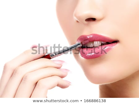 Beauty female face. Professional glossy lip makeup. Pink lip gloss and lipstick Stock photo © serdechny