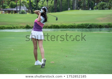 Golf player swinging club on fairway. Stock photo © lichtmeister