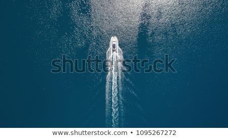 волна лодка поверхности воды круиз горизонте синий Сток-фото © vapi