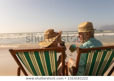 вид сзади старший человека расслабляющая солнце пляж Сток-фото © wavebreak_media
