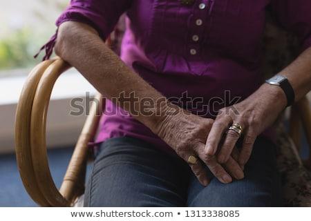 Senior vrouw vergadering gevouwen handen Stockfoto © wavebreak_media