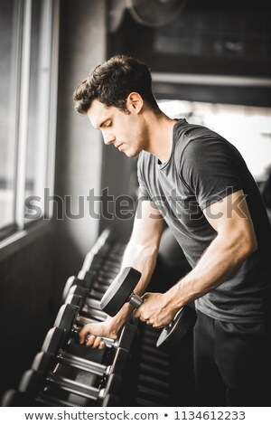 Endurance, sport, healthy lifestyle concept. Handsome young man satisfied with own body shape, showi Stock photo © benzoix