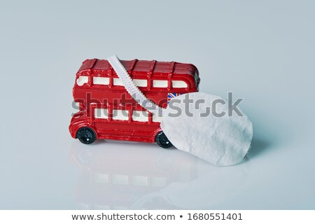 miniature of red double-decker bus and face mask Stock photo © nito
