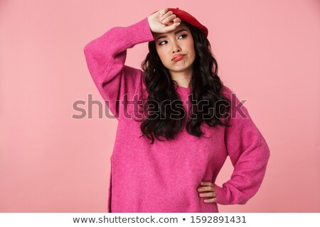 Image of tired beautiful asian girl wearing beret looking at cop Stock photo © deandrobot