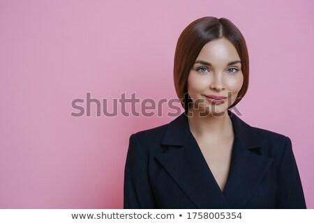 Elragadtatott gyönyörű nő iroda ruházat sötét haj Stock fotó © vkstudio