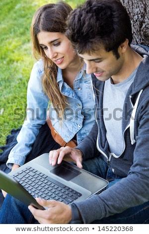 Portre iki gülen kadın dizüstü bilgisayar kullanıyorsanız yeşil Stok fotoğraf © HASLOO