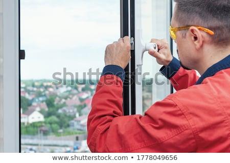 Man fitting a window lock Stock photo © photography33