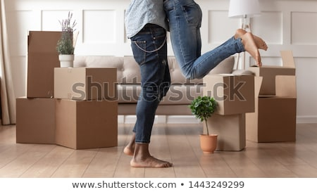 young man surrounded by boxes moving into a new apartment stock photo © photography33