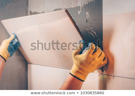 A man about to lay tiles. Stock photo © photography33