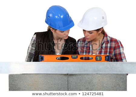 Tradeswomen examining a blueprint together Stock photo © photography33