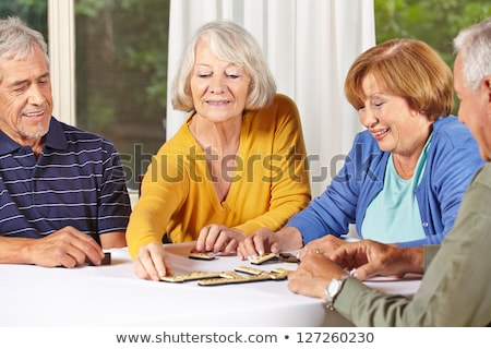 Old woman playing dominos Stock photo © photography33