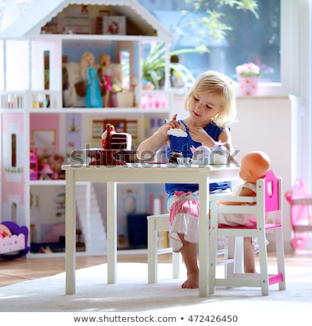 Young girl playing with her tea set Stock photo © photography33