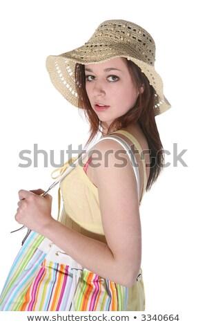 Girl hiding over a purse  stock photo © oneinamillion