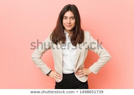 Portrait of a brunette businesswoman hands on hips against a white background Stock photo © wavebreak_media