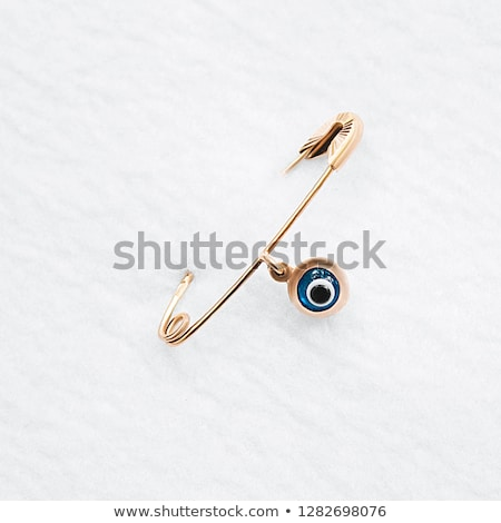 One safety pin open against a white background Stock photo © wavebreak_media