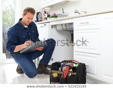 Handsome repairman with clipboard Stock photo © wavebreak_media