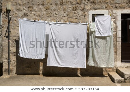 Stock photo: Laundry drying on the rope outside
