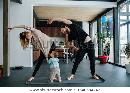Mother and son doing exercise at home stock photo © HASLOO