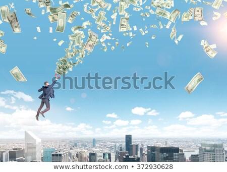 Jóvenes empresario dinero tornado foto papel Foto stock © NeonShot