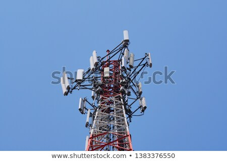 cell phone tower antenna against blue sky stock photo © tungphoto