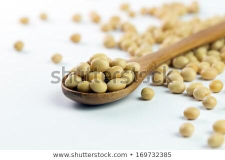 Soybean in wooden spoon Stock photo © stoonn