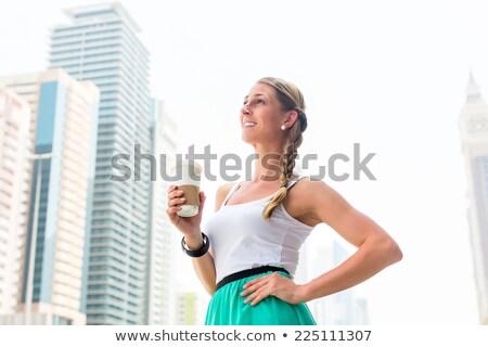 Woman enjoying coffee to go in metropolitan city  Stock photo © Kzenon