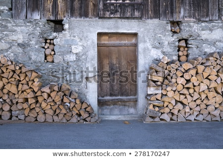 Fire Wood Stacked Outside Barn Door Stock photo © belahoche