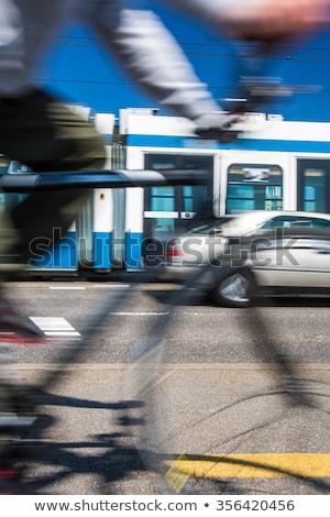 Város közlekedés ingázás bicikli autó busz Stock fotó © lightpoet