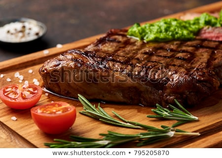 Angus Beef Steaks With Roasted Tomato Sauce Stock photo © Alex9500