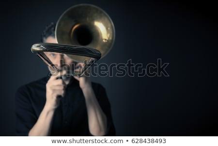 Dark portrait of a trombonist Stock photo © andreasberheide