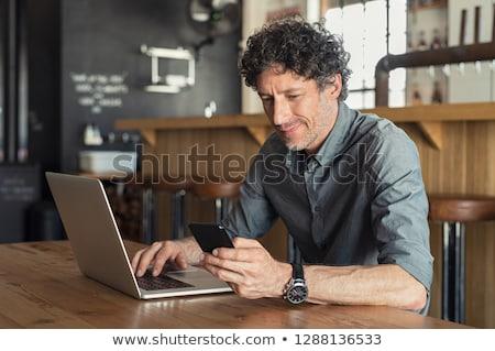 зрелый человек используя ноутбук ресторан портрет компьютер любви Сток-фото © wavebreak_media