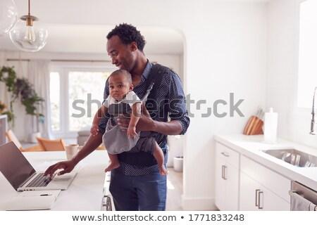 Baba çalışma dizüstü bilgisayar bebek adam Stok fotoğraf © IS2