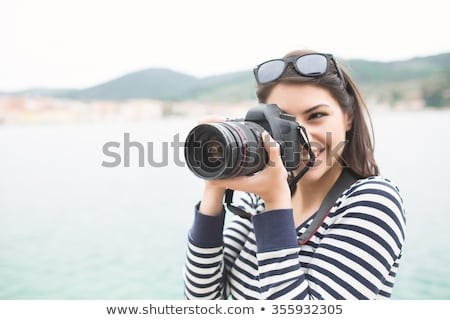 Stock photo: woman with DSLR taking a photograph