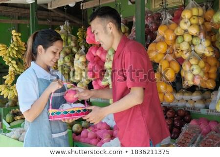 Homem lojista fruto mulher comida Foto stock © IS2