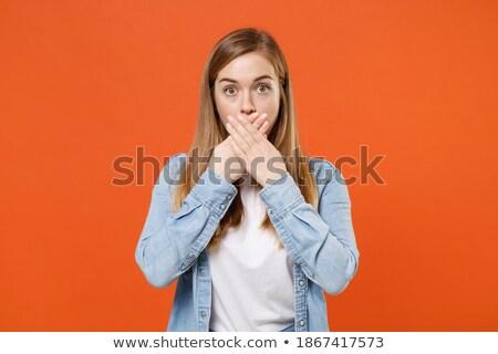 Geschokt vrouw denim kleding naar camera Stockfoto © deandrobot